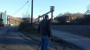 Filmmaker Slater Teague filming an abandoned coal facility in Kentucky