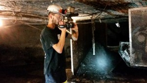 Teague filming in a coal mine in Kentucky