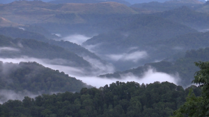 Fog consumes a valley as nightfall approaches in Pike County, KY